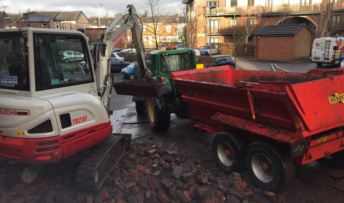 Waste removal with tractor, trailer and mini digger